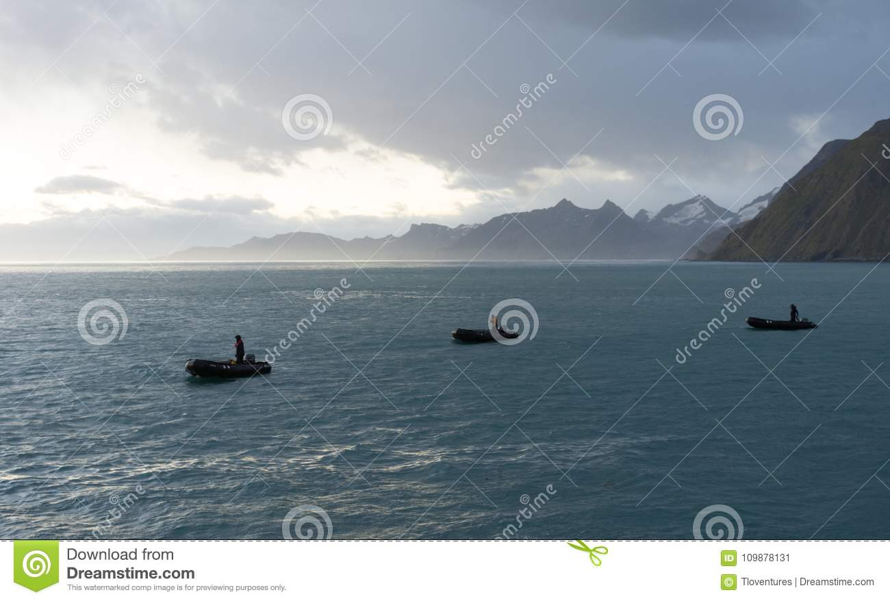 Three Zodiaks with Drivers at Sunrise