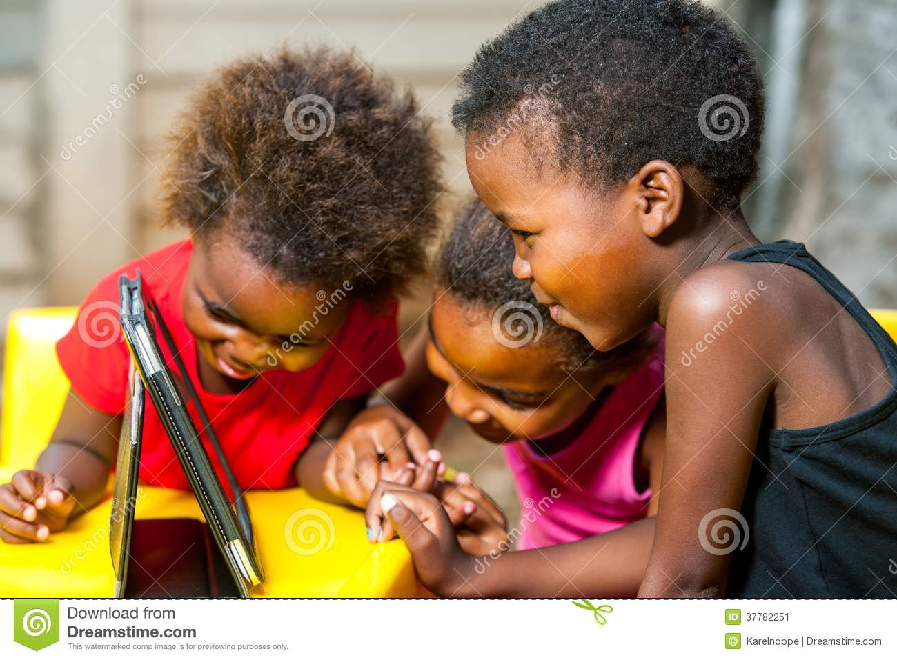 Threesome African Kids Having Fun With Tablet Stock Image - Image 37782251-5955
