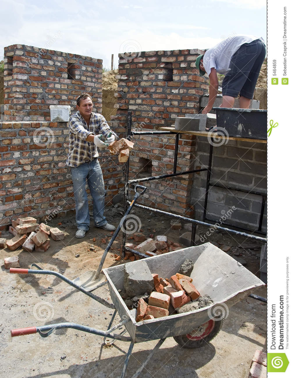 Throwing bricks wheelbarrow stock image image of workman for Help me build a house