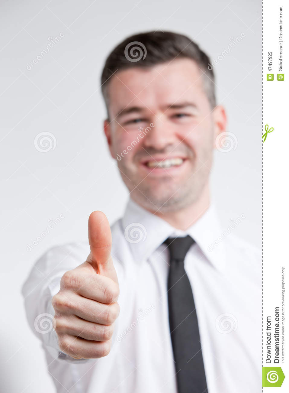 Thumb up for happy young man