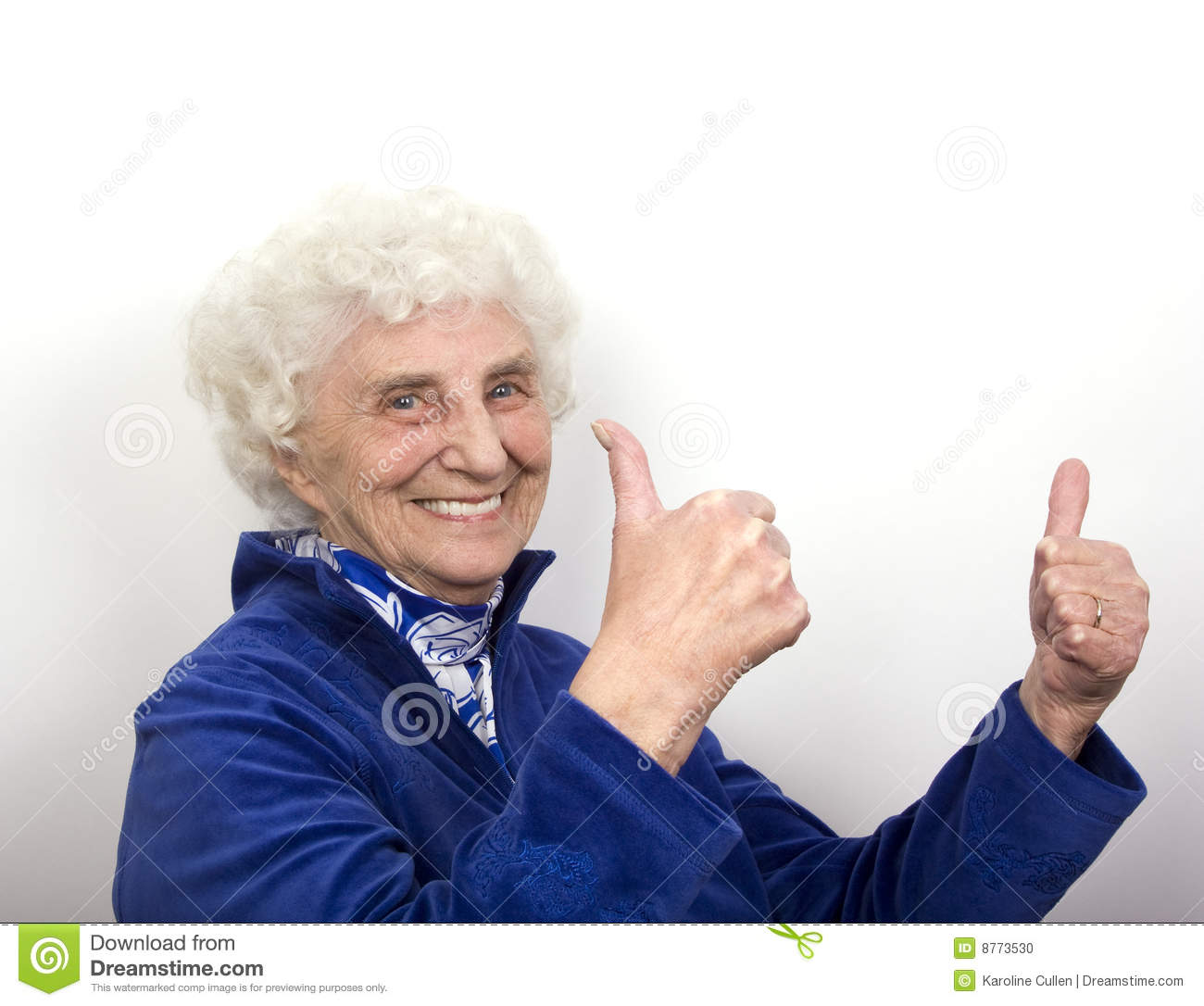 granny with white hair and blue eyes gives an enthusiastic thumbs up ...