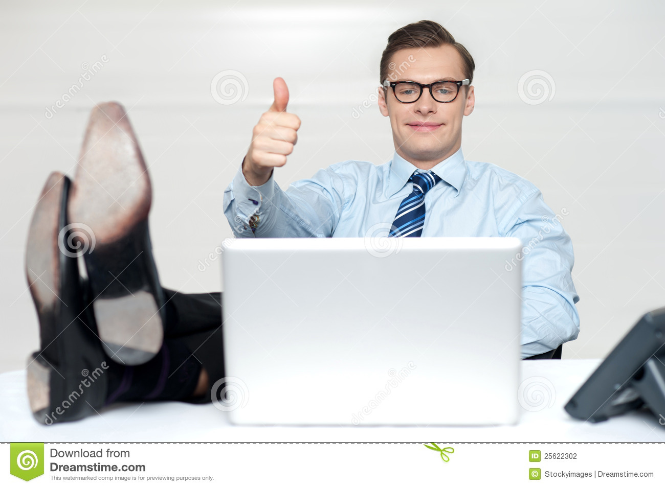 Thumbs Up Guy Relaxing With Legs On Work Desk Stock Photography ...