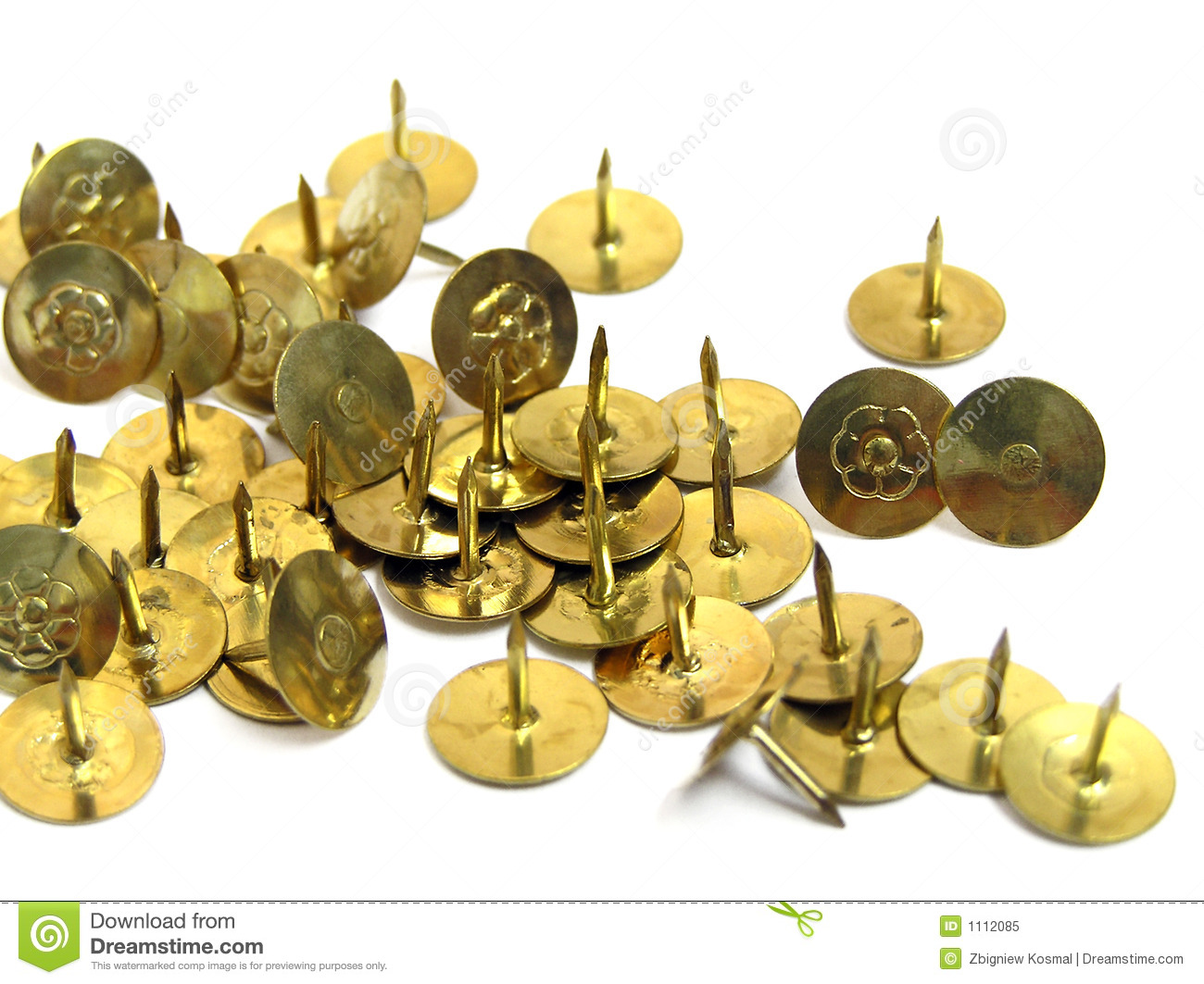 The group of zloties of thumbtacks on white background.