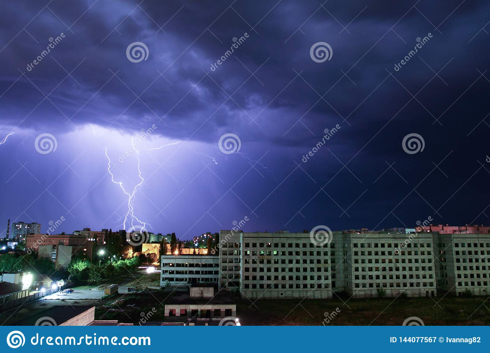 Thunderbolt over the house. Storm outside. Thunderstorm with lightning in the city