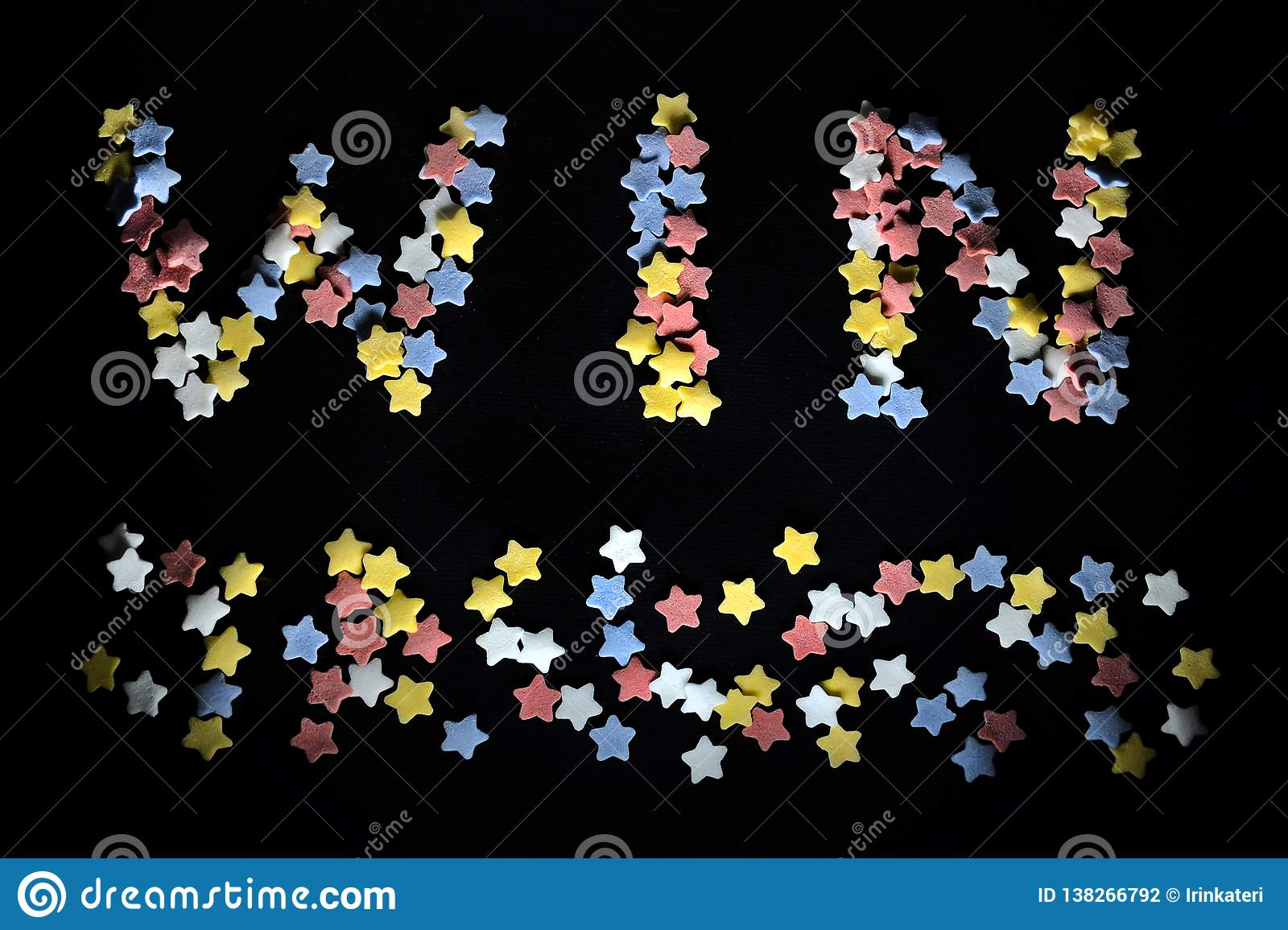 Thw word Win in red white yellow and blue sugar stars, for business, coaching, sports fans, success, winning