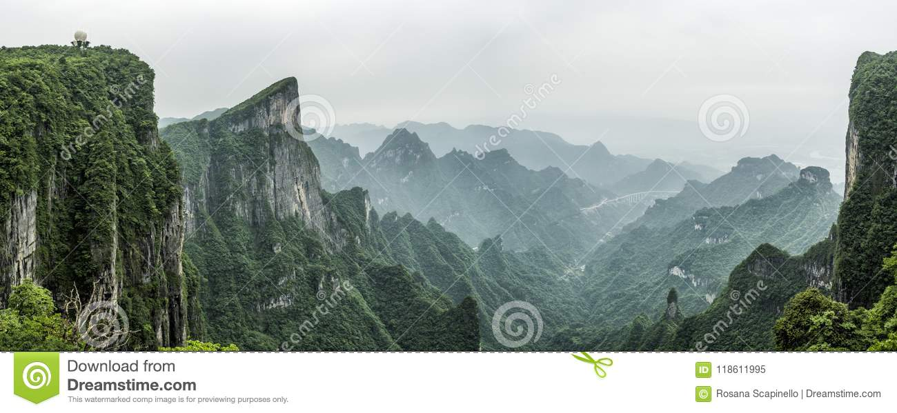 Tianmen Mountain Known as The Heaven`s Gate surrounded by the green forest and mist at Zhangjiagie, Hunan Province, China, Asia