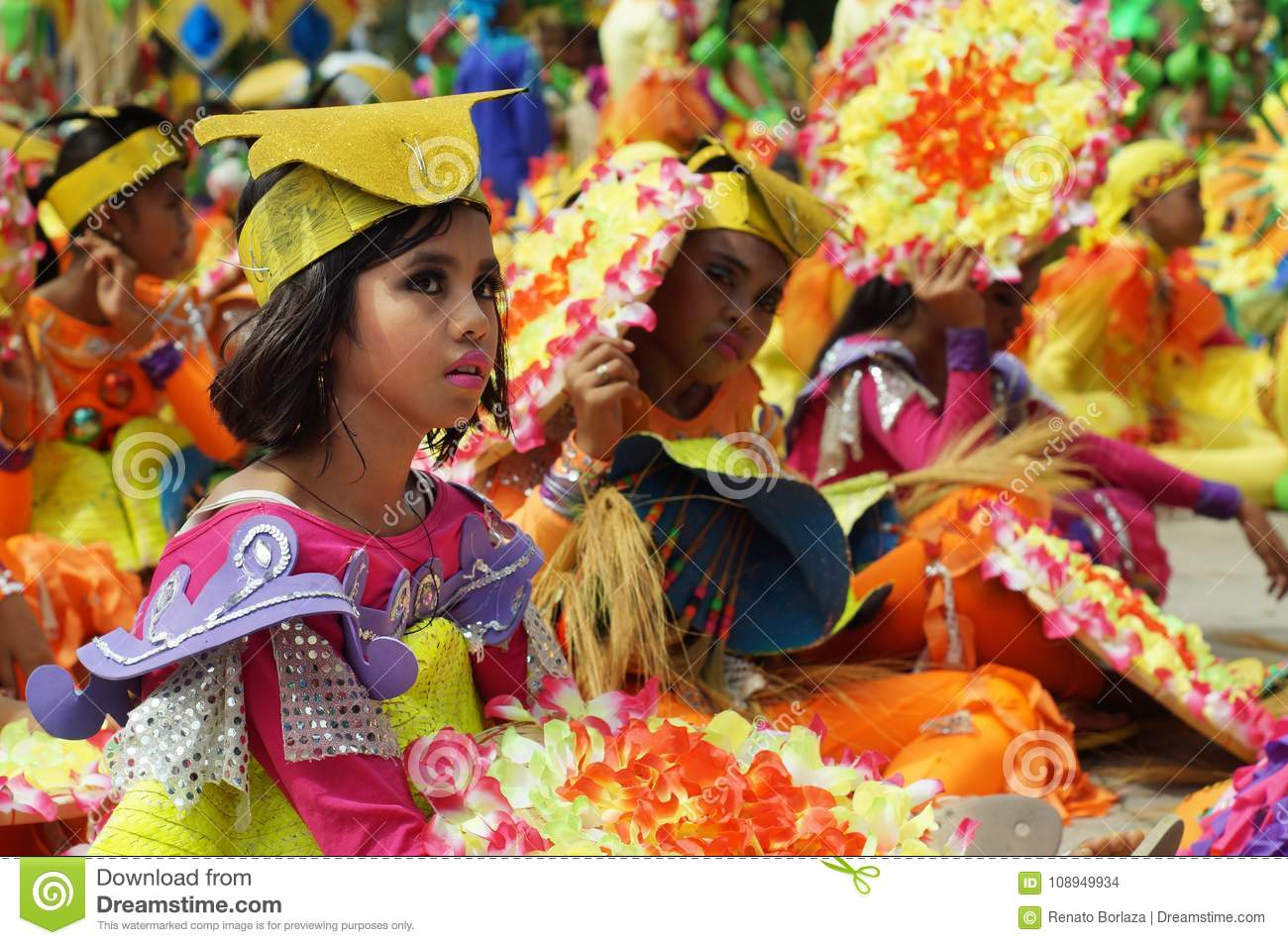 Sitting participant in diverse costumes of street dancer