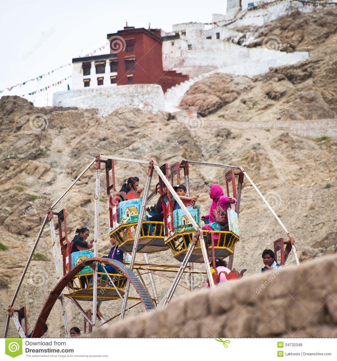 Tibetan people at fairground enjoying ferris wheel