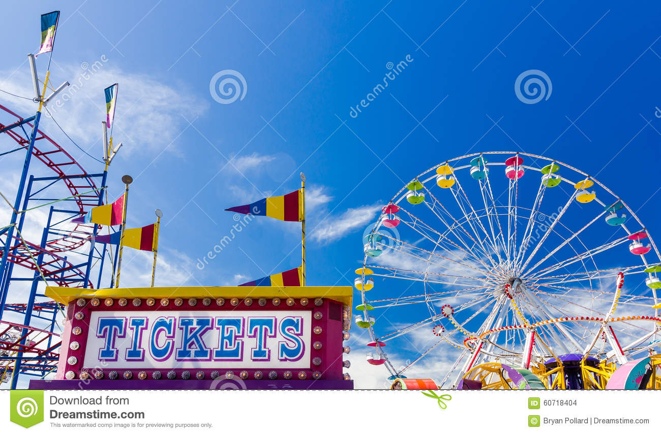 Download Ticket Booth And Rides At A Carnival Against Blue Sky Stock Photo - Image of classic, sign: 60718404