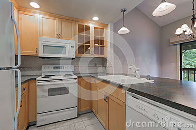 Tidy Compact Kitchen With Maple Cabinets Stock Image ... on Kitchen Backsplash With Maple Cabinets  id=63453