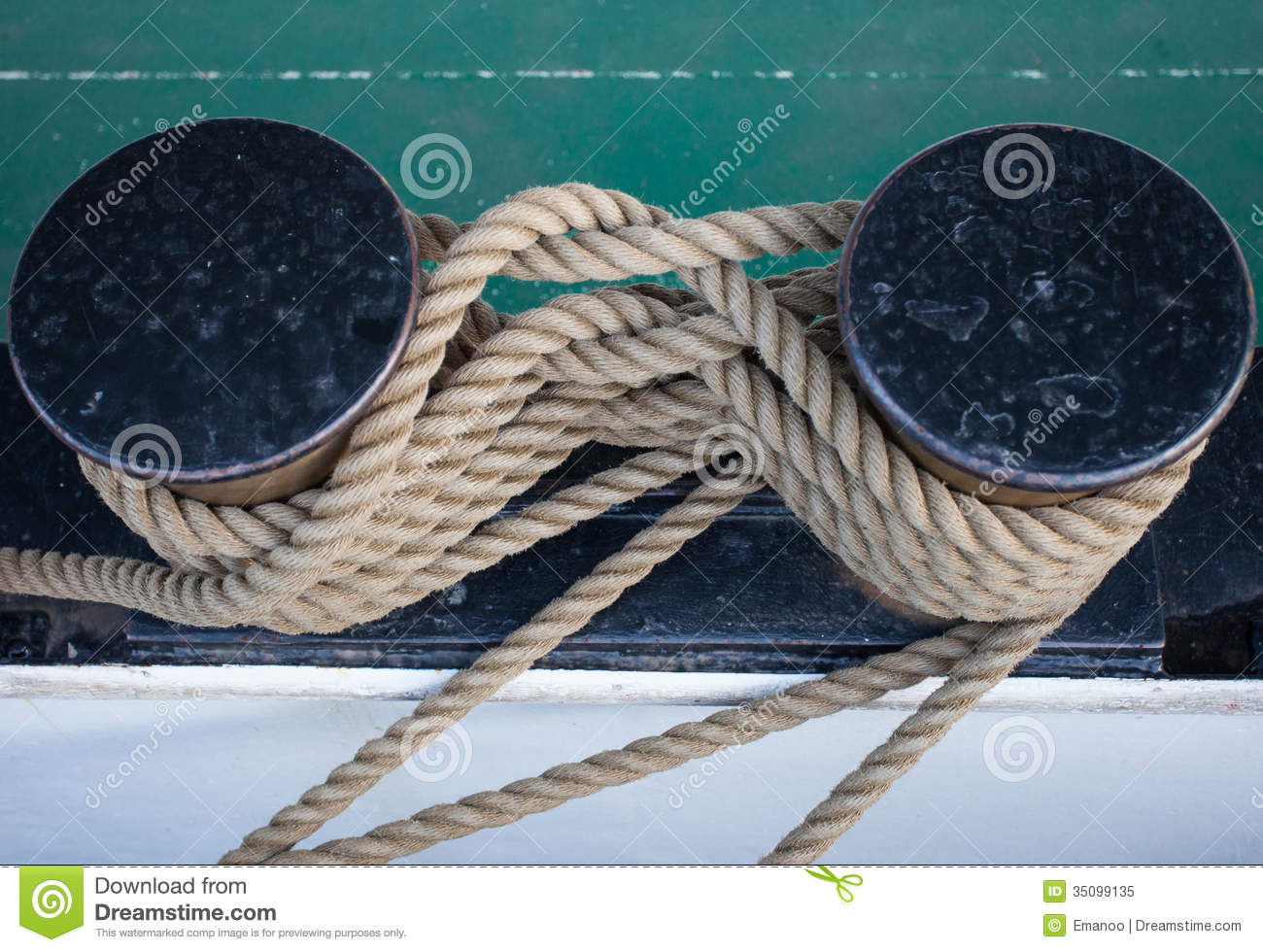 Tied rope on ship in harbor