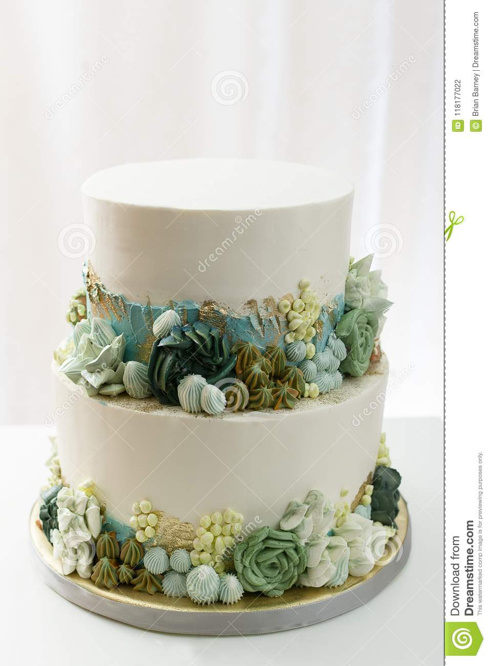2 Tier Wedding Cake | 2 Tier Wedding Cake With Butter Cream Floral Accents Stock Photo