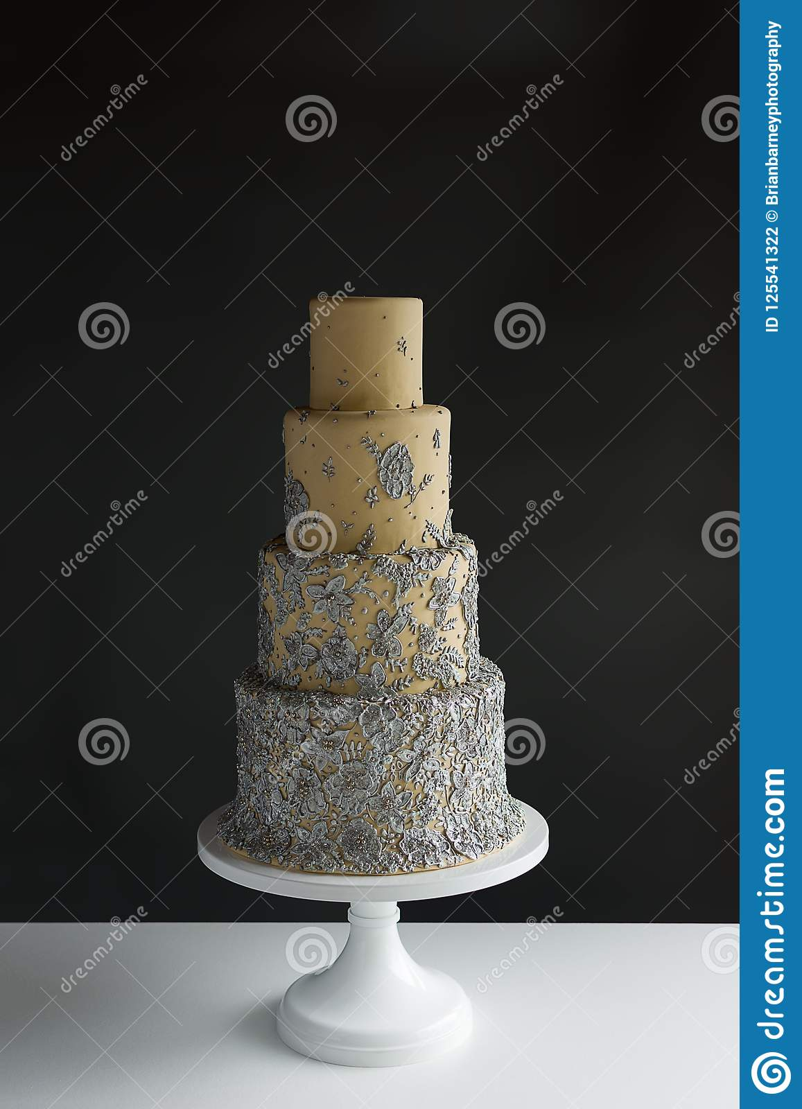 4 Tier Wedding Cake With Silver Floral Accents On White Table With With Dark Grey Background And Copy Space Stock Photo Image Of Marble Beautiful 125541322