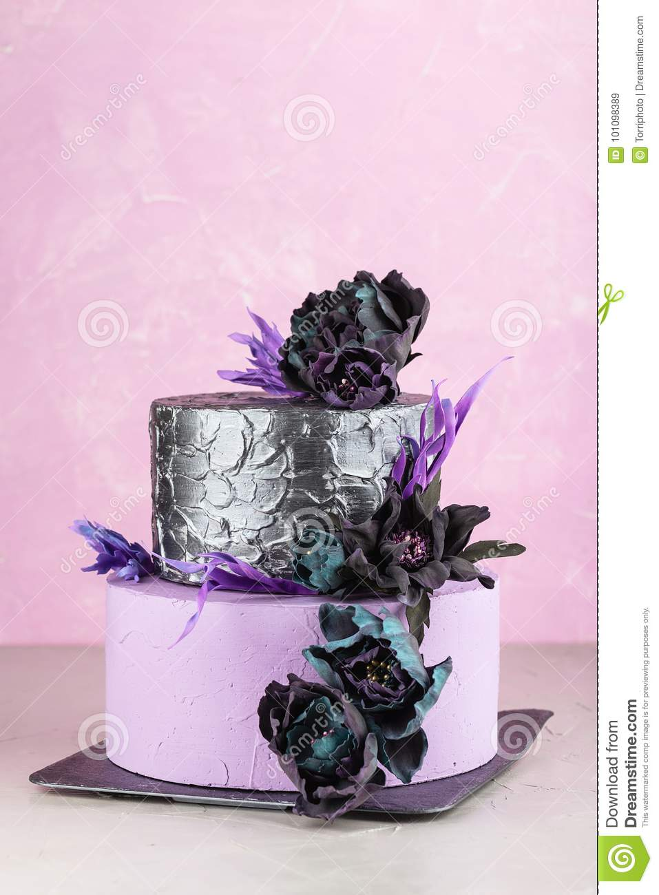 Tiered Wedding Cake With Black Fake Flowers Stock Image - Image of ...