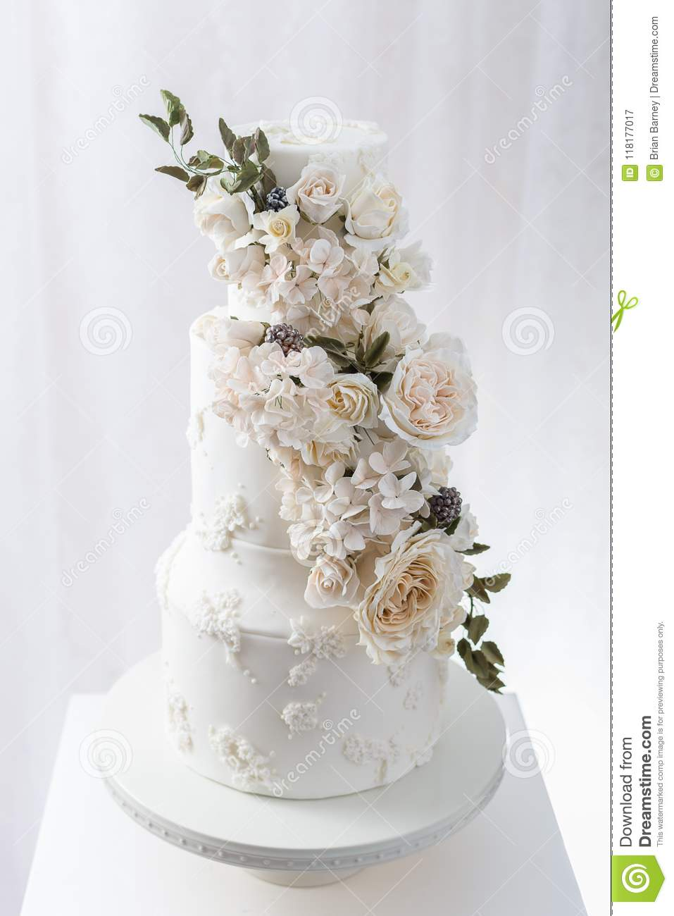 Tiered Wedding Cake With Edible Flowers Stock Image - Image of ...