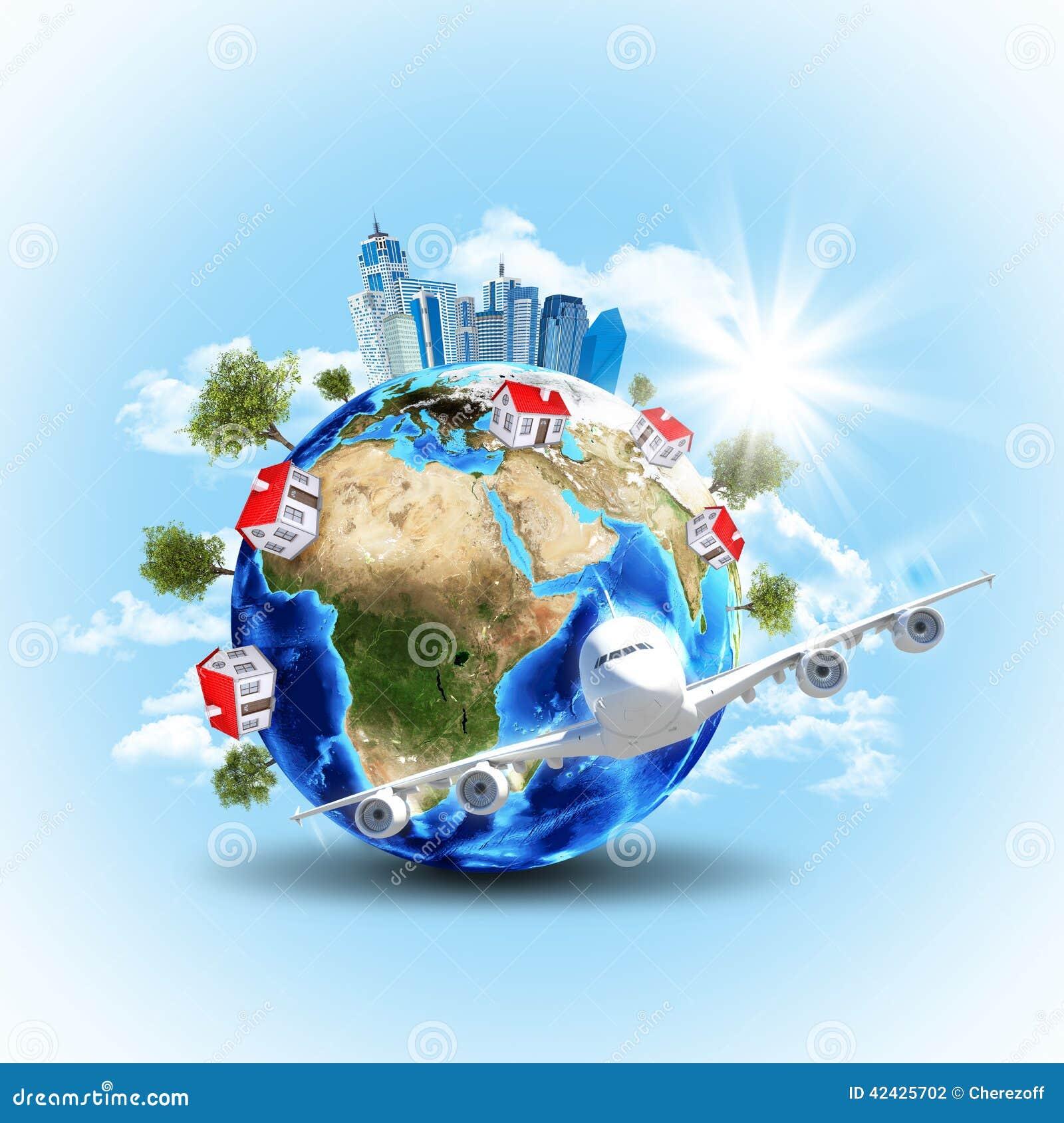 Tierra con los edificios y el aeroplano