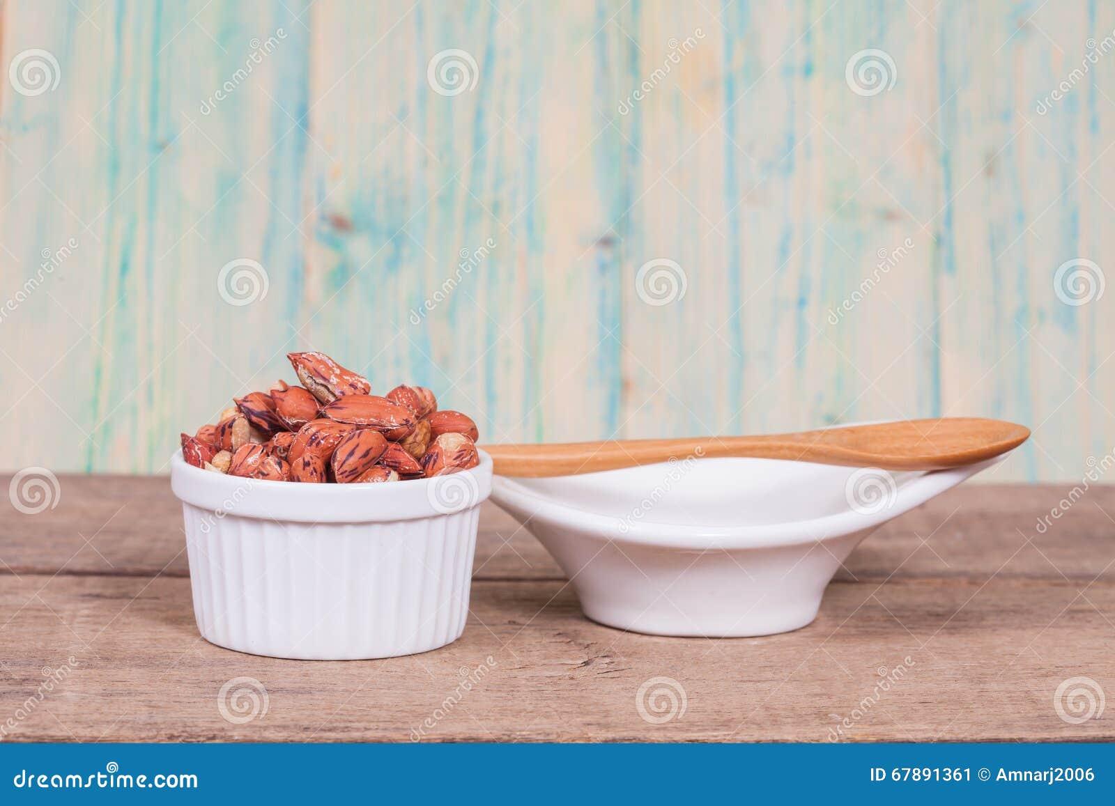 Tiger peanut in bowl on wood