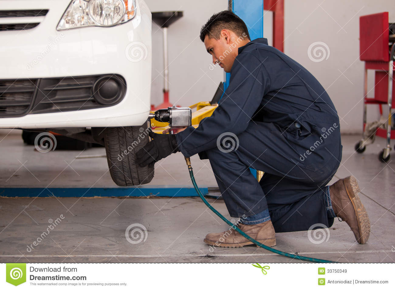 Tune Up Prices >> Tightening Bolts Of A Tire Royalty Free Stock Images - Image: 33750349
