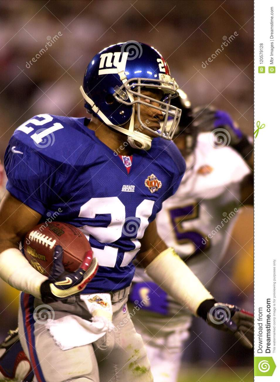 79c9b552a5d Tiki Barber for the New York Giants in game action during Super Bowl XXXV  vs the Baltimore Ravens. The Ravens defeated the Giants by the score of  34–7, ...