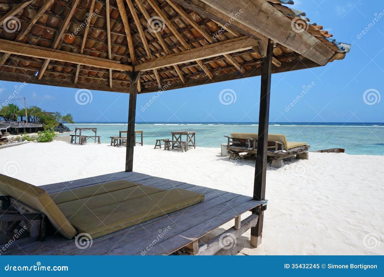 Tiki Hut On White Sand Beach Royalty Free Stock Photo