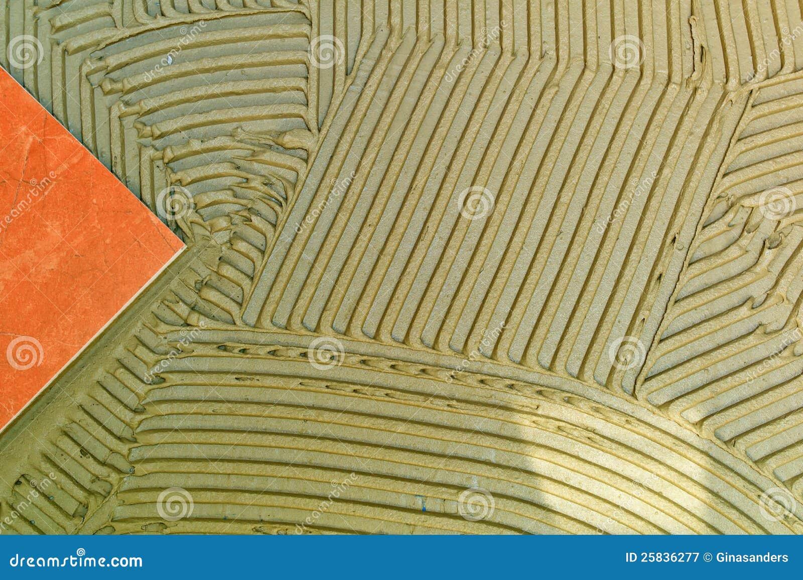 Tile adhesive on a wall