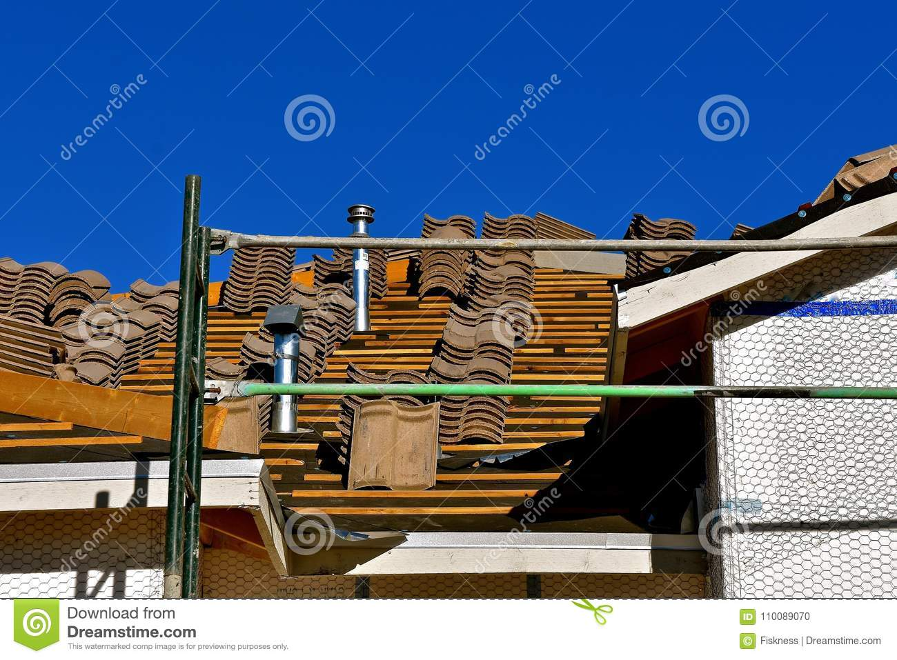 Tile Shingles Stacked On A Roof Under Construction Stock Photo