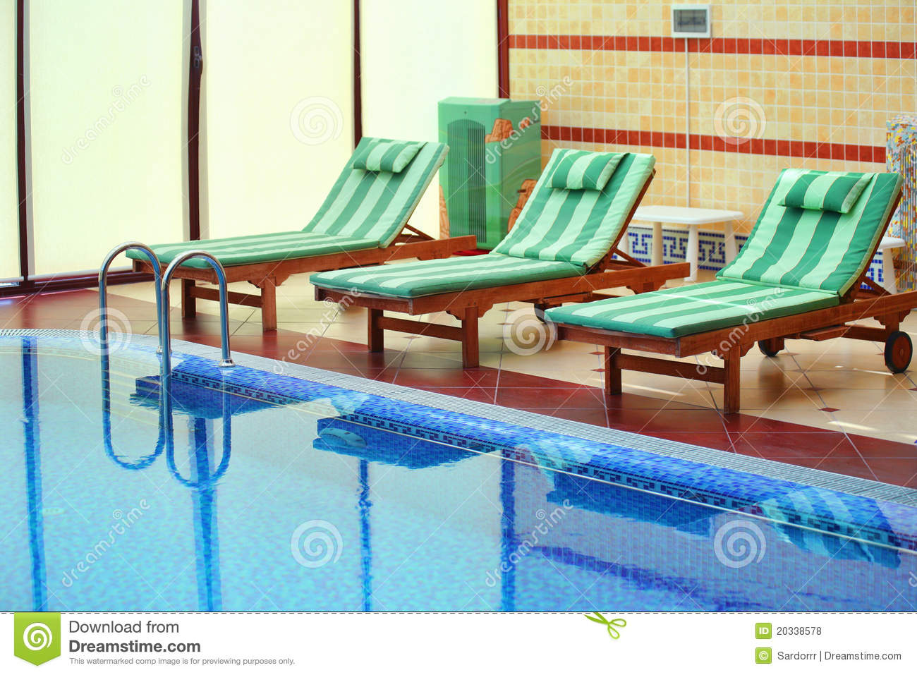 Tiled swimming pool with bed chairs royalty free stock for Swimming pool bed