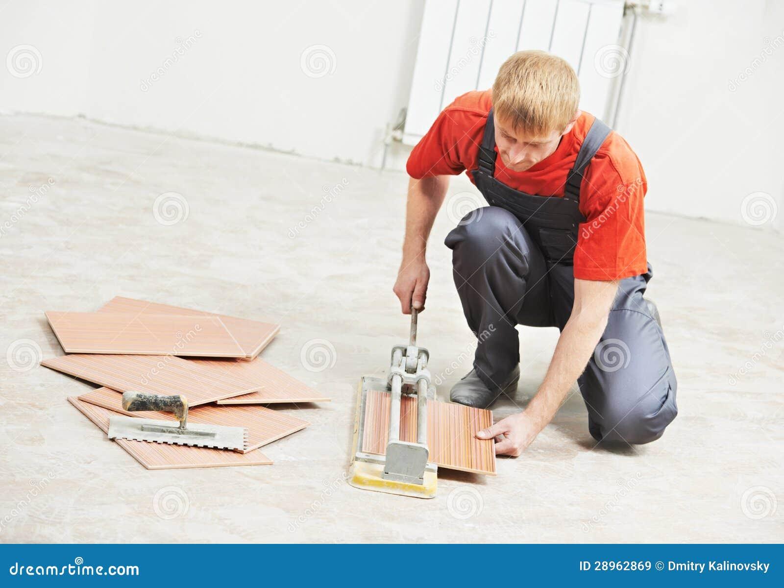 Tile Business Working : Tiler cutting tile at home renovation work royalty free
