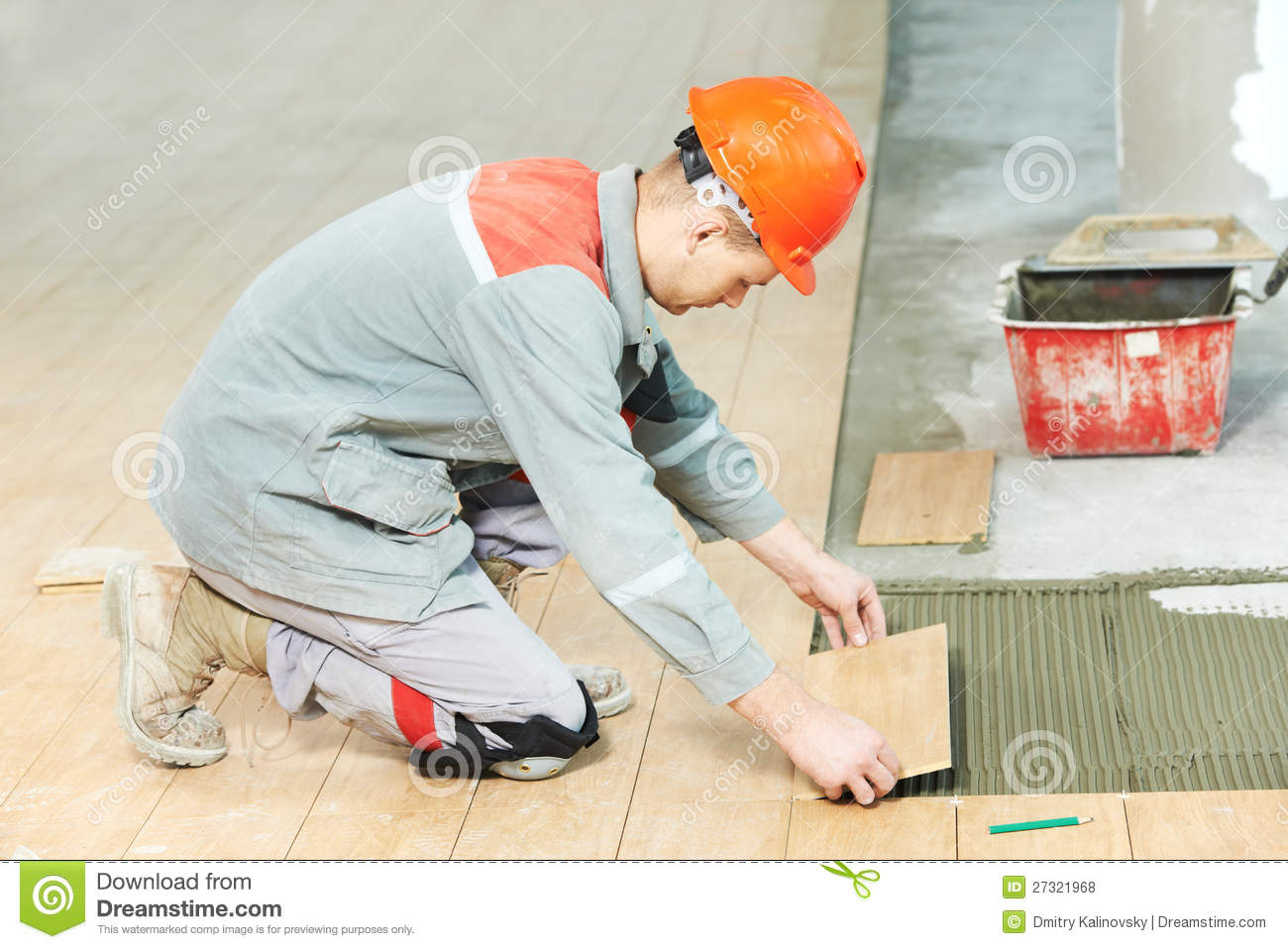 Tiler at industrial floor tiling renovation work stock for Peinture renovation carrelage