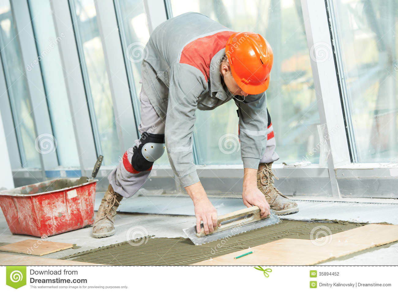 Floor Tile Workers : Tiler at industrial floor tiling renovation work stock