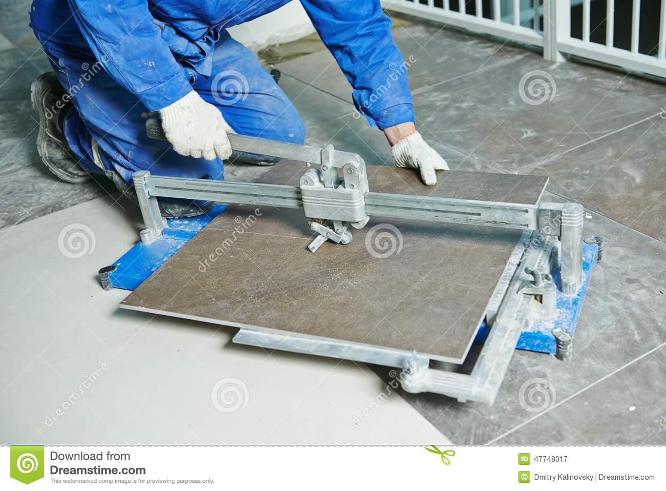 Floor Tile Workers : Tiler working with tile cutting equipment stock image
