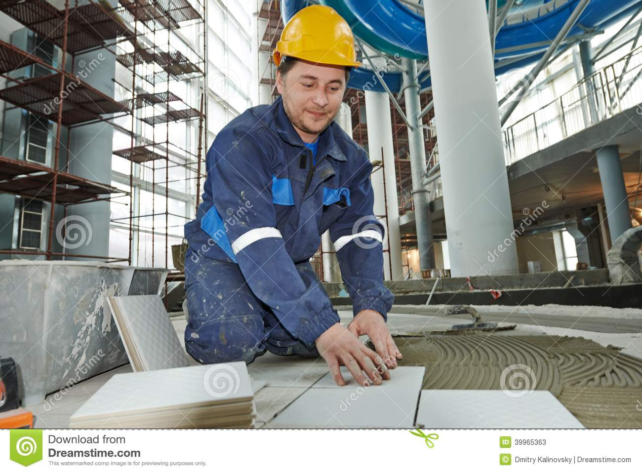 Floor Tile Workers : Tilers at industrial floor tiling renovation stock image