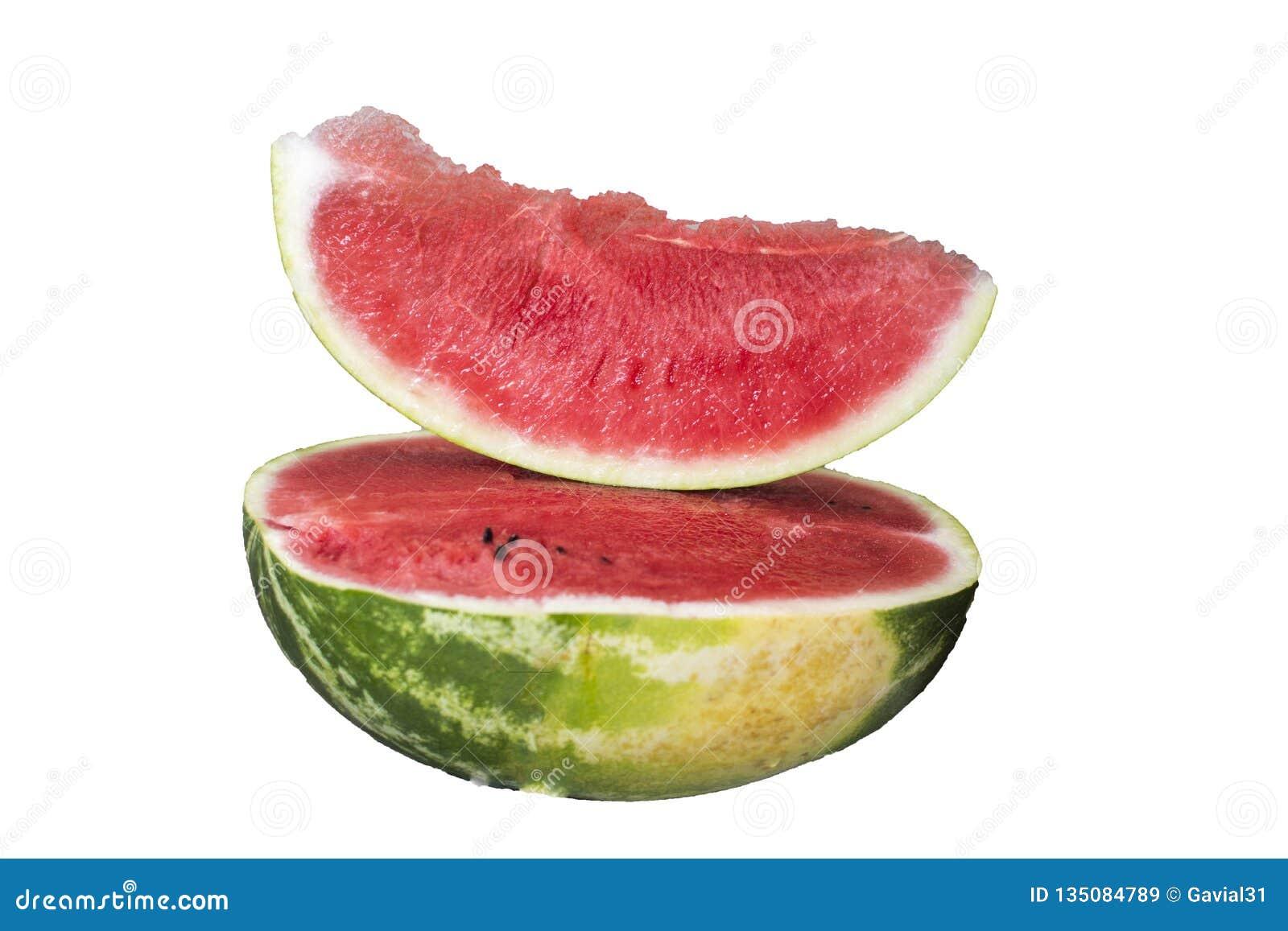 Till hälften en skiva av den läckra mogna vattenmelon