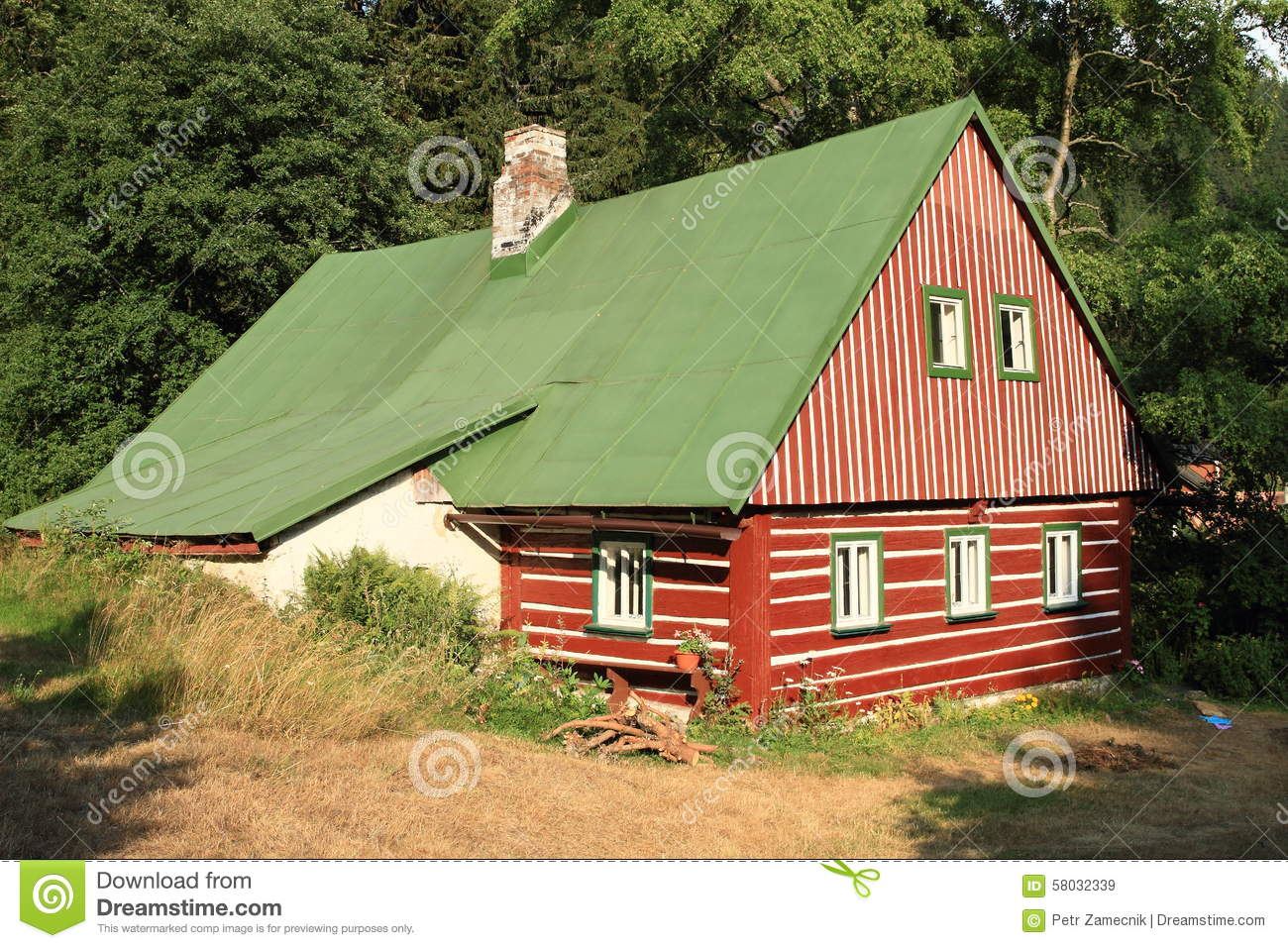 Timbered mountain cottage - Brown house with green roof ...