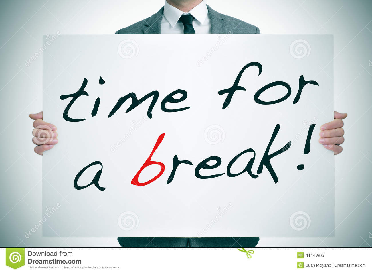 Businessman holding a signboard with the text time for a break written ...