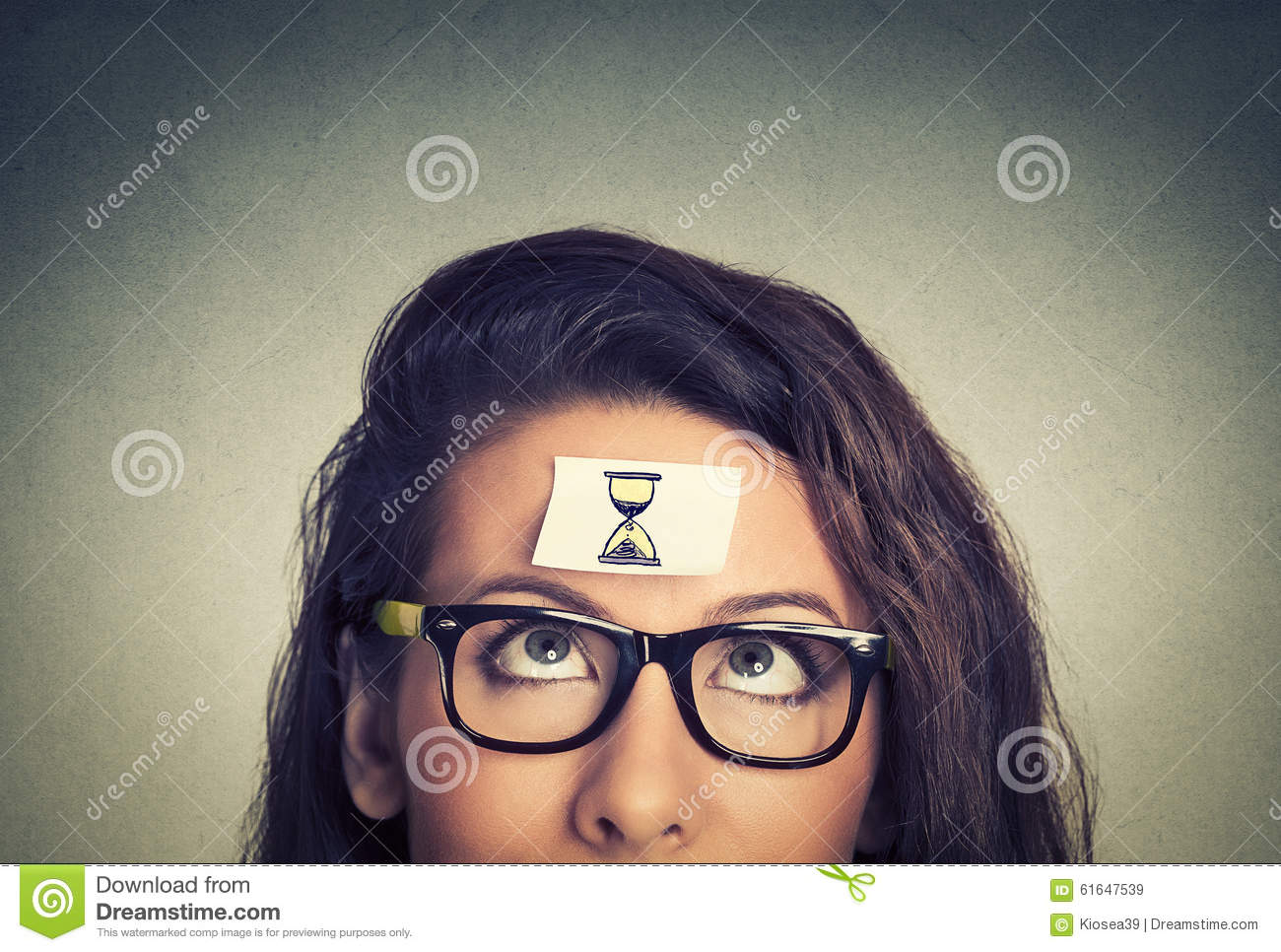 Time management. young woman with sand clock sign