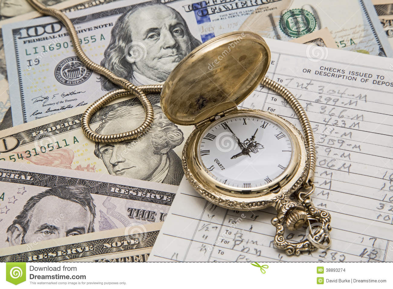 time money management pocket watch checkbook stock photo