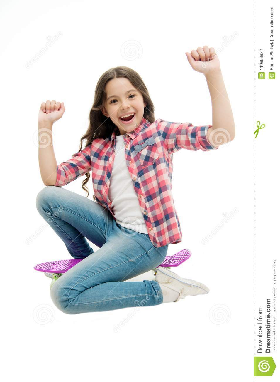 Time to ride. Kid girl excited sits penny board. Modern teen hobby. Girl happy face sit on penny board white background