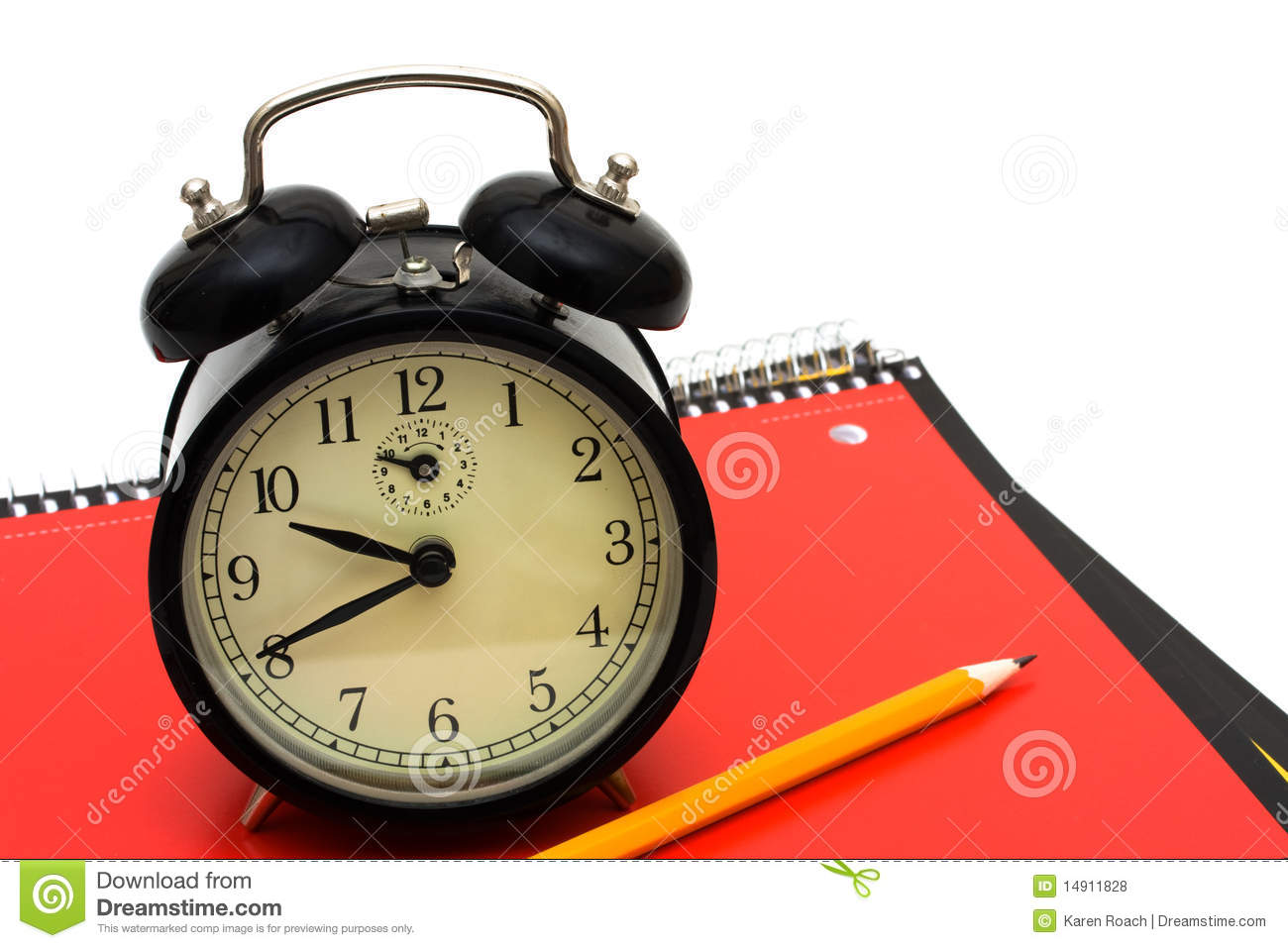 An old fashioned clock on a books isolated on a white background time