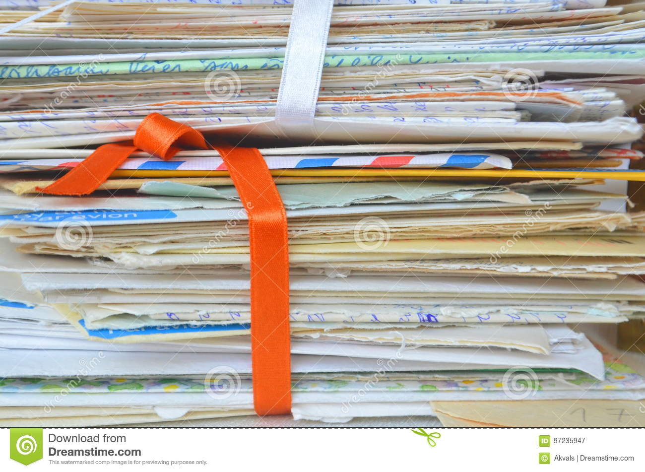 Times gone by - slow mail communication, memories, closeup of old handwritten letters for backgrounds