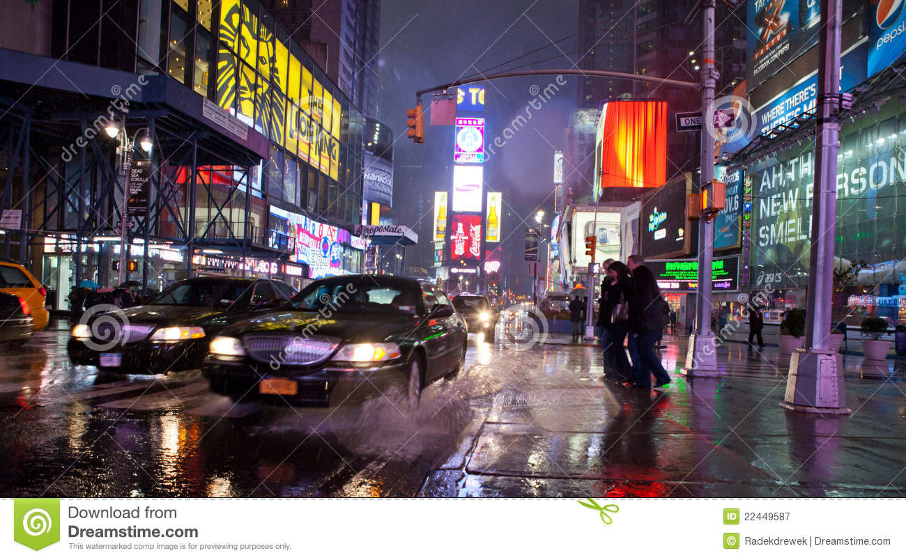 Times Square during rainy weather.