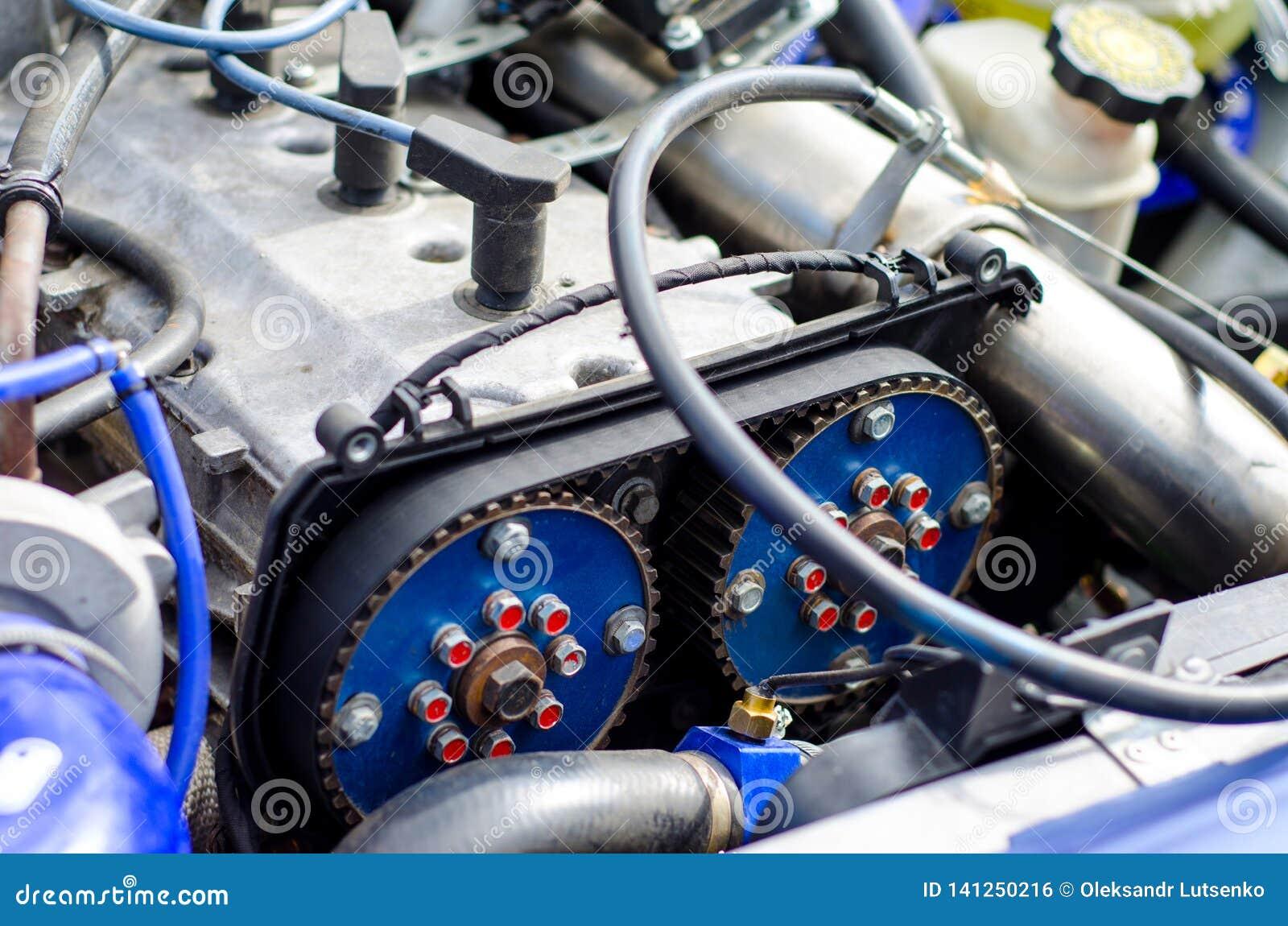 Timing belt and camshaft sprocket in engine