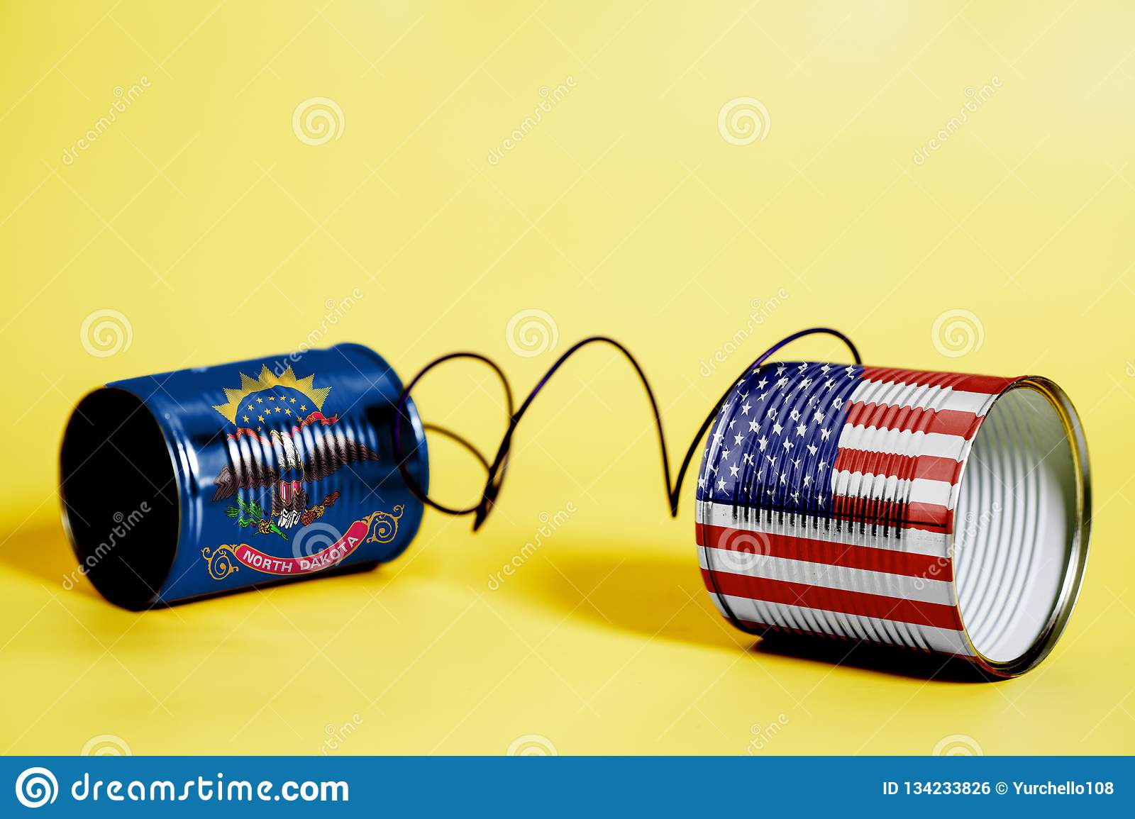 Tin can phone with USA and North Dakota State Flags. communication concept