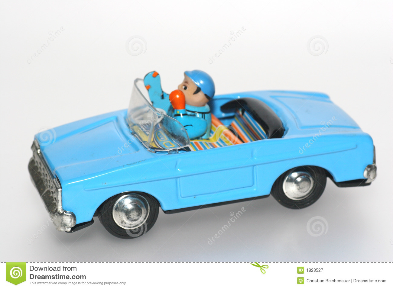 Tin toy car with driver