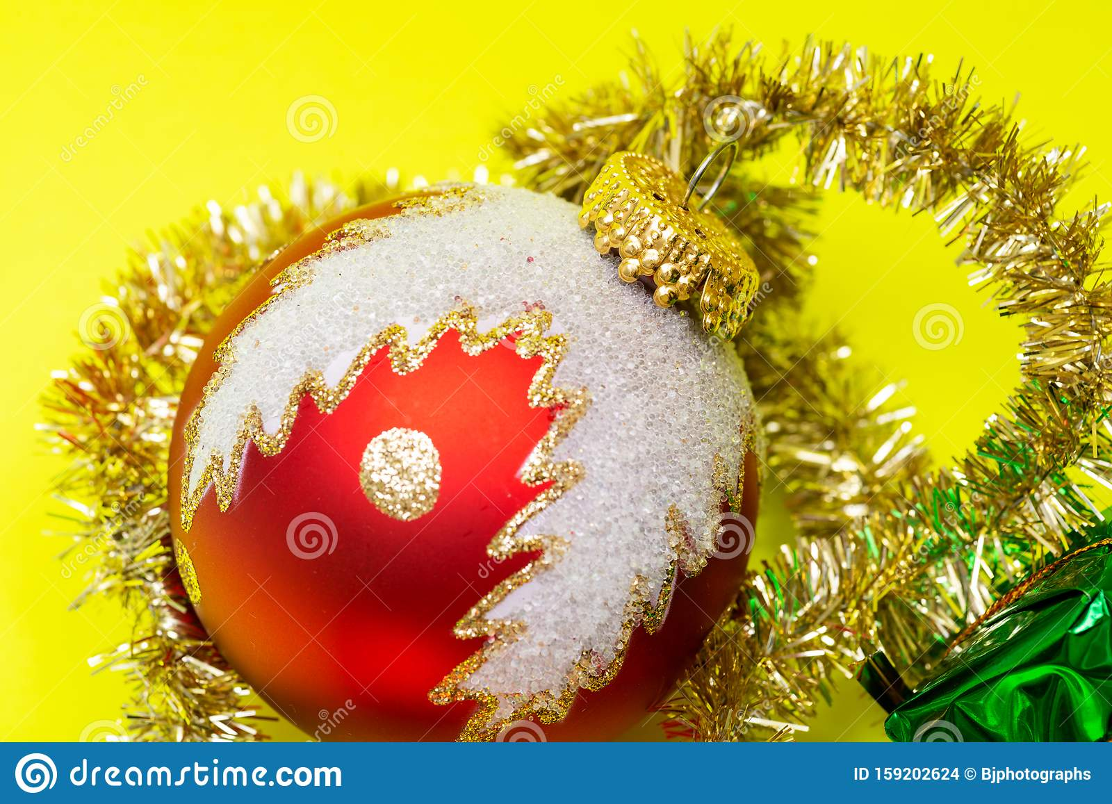 Tinsel Garland And Vintage Christmas Tree Ball Isolated On Bright Yellow Background Winter Holidays Decoration Stock Photo Image Of Celebration Festive 159202624