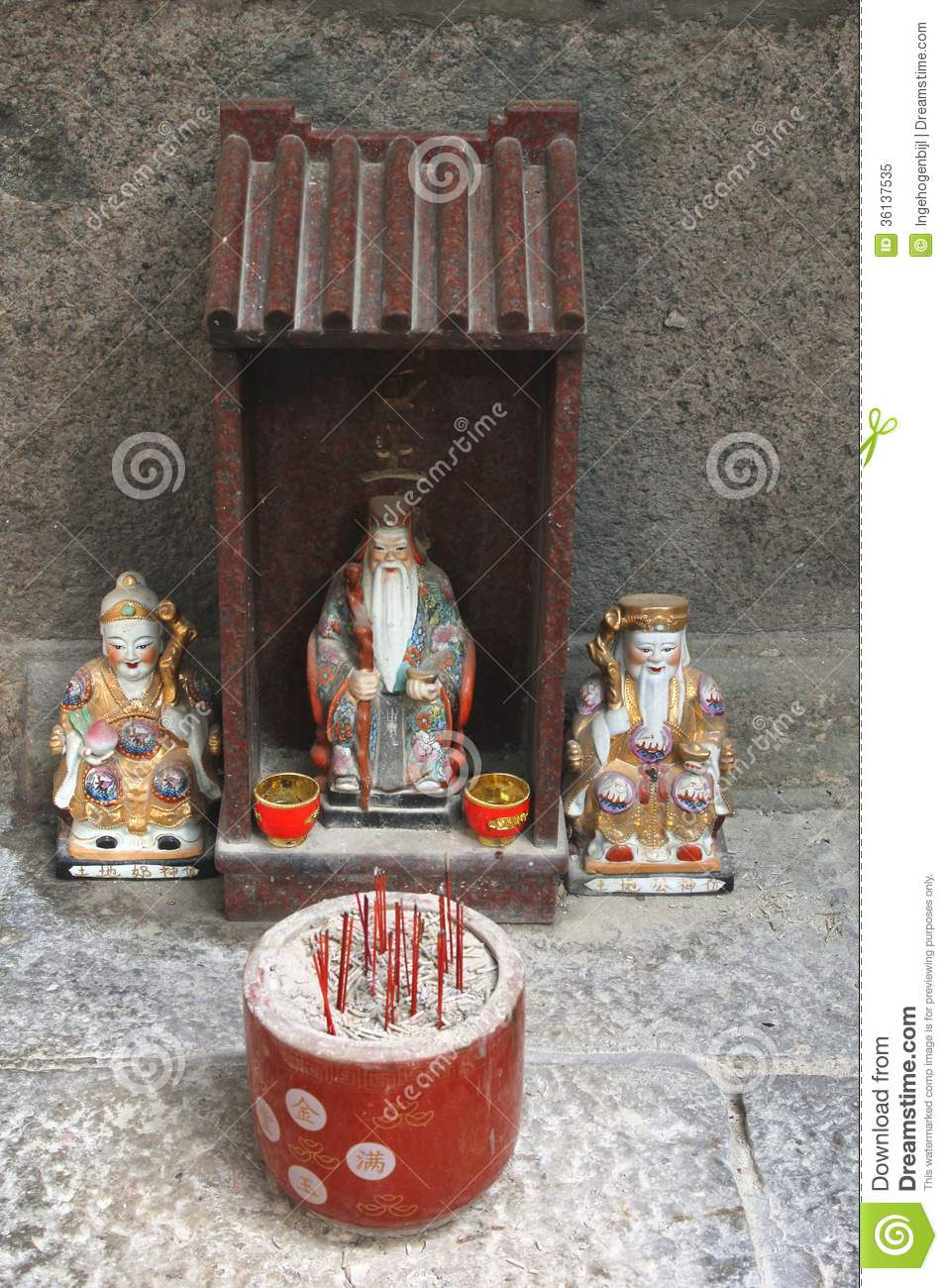 Tiny Altar With Incense And Porcelain Statues In A Chinese