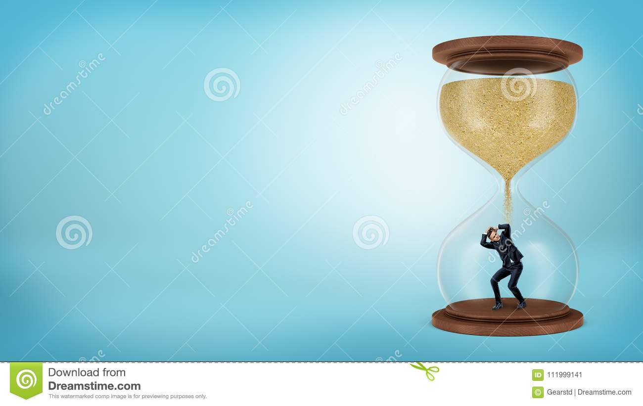A tiny businessman stands inside a hourglass when the sand only starts to fall over him.
