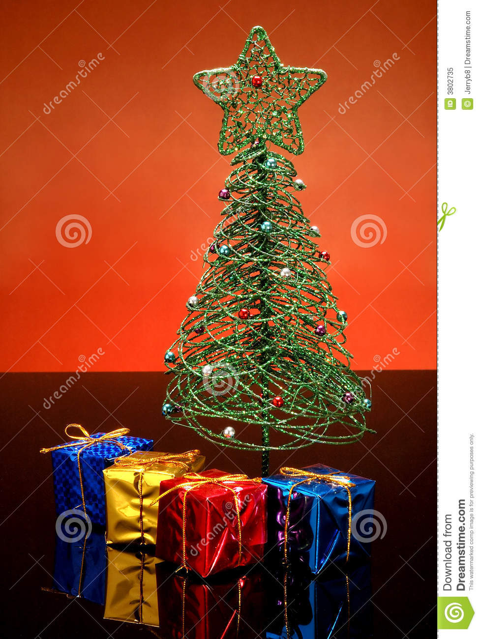 Tiny Christmas Tree And Gifts Stock Image - Image of wound, green ...