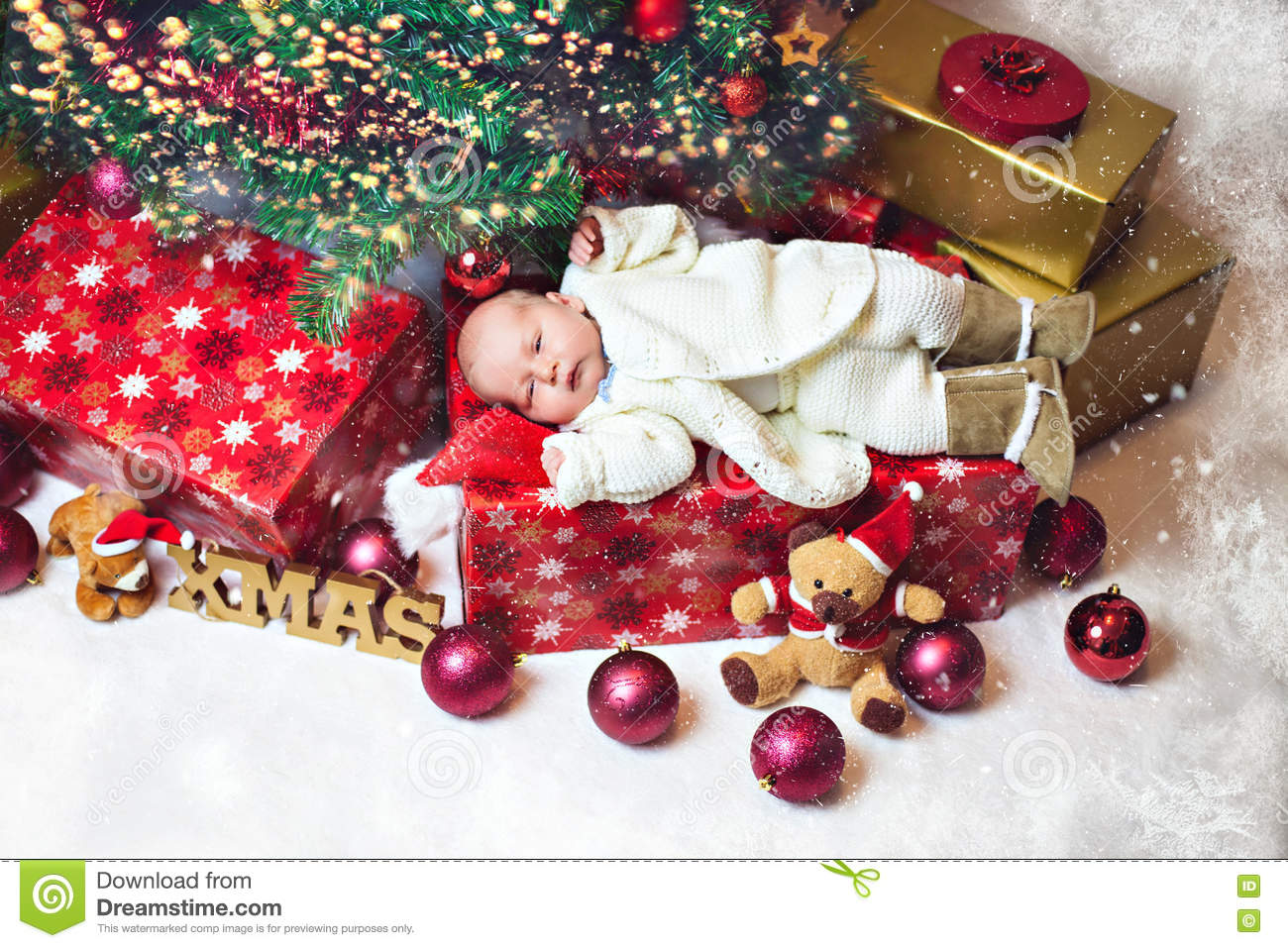 Tiny Cute Baby Lying On A Christmas Gift Box Stock Image - Image of ...
