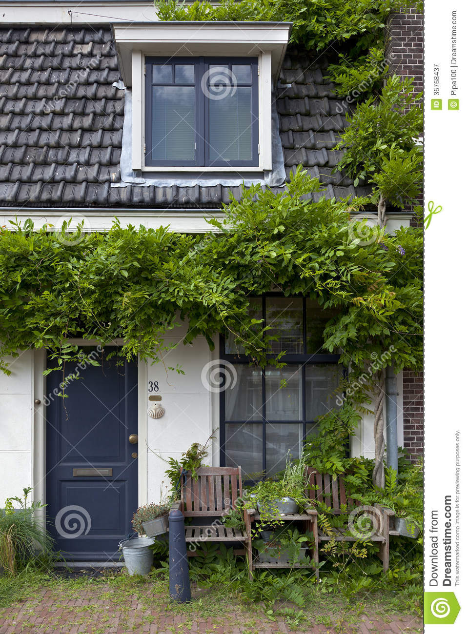 Tiny House With Green Plants Royalty Free Stock